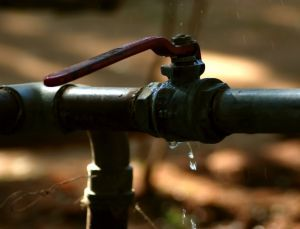 A pipe valve, wasting water as it drips